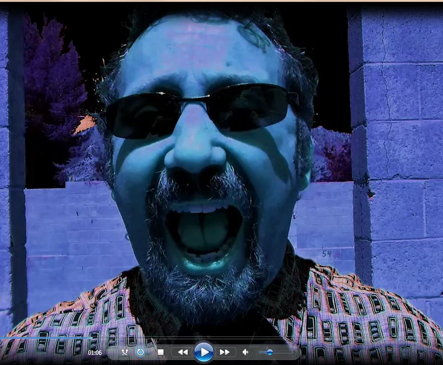 Blue-tinted image of man's face yelling into camera