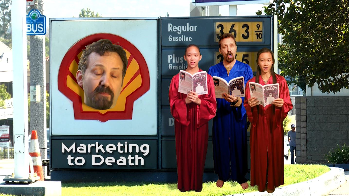 Three robed choir singers perform in front of Shell gas station sign